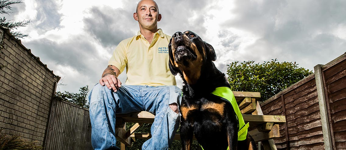 One of the Pets As Therapy volunteers with his dog